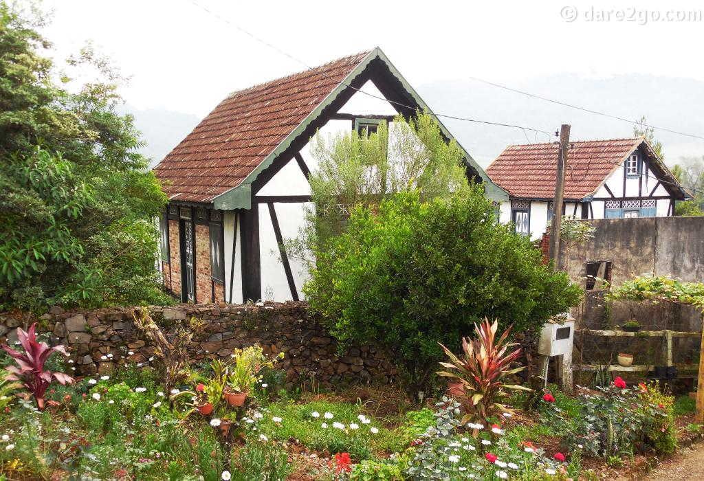 "neatly restored German ""Fachwerk"" houses near Nova Petropolis in Brazil."