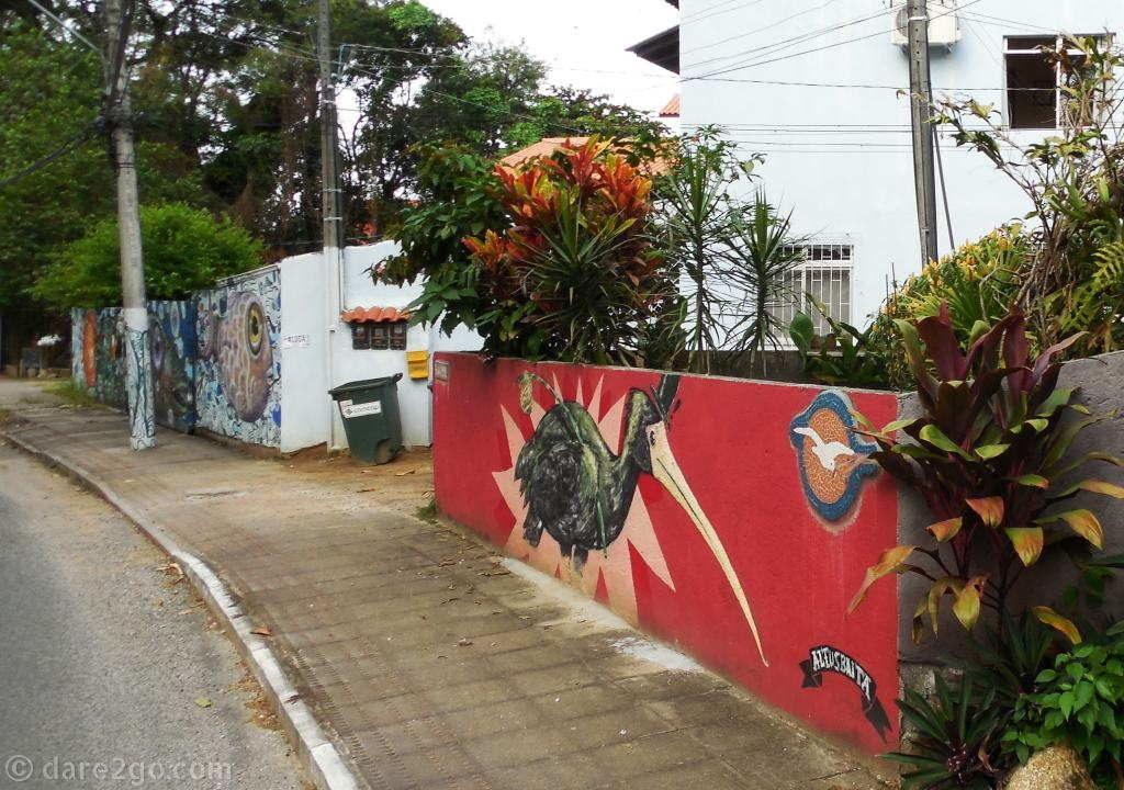 Floripa: decorated power poles and street art walls inland of Ilha de Santa Catarina