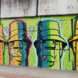 The twelfth (and last) section of the overpass wall. Here it gets rather low - these faces just fit.