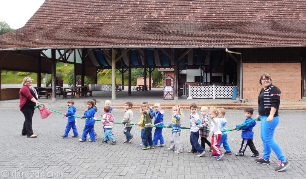 Multi-racial pre-school kids wandering past our camper in Pomerode, Brazil.