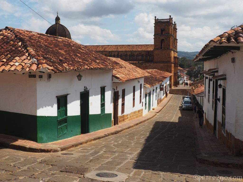 Small Heritage Towns of Colombia: Barichara can get busy with local tourists during long weekends and holidays. At other times, it's a small, sleepy town with cobbled streets, white houses, and terracotta tiled roofs. A plus for overlanders: it's a pleasant town to camp, on top of the hill overlooking the canyon!