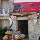 Door-to-door salesmen create a different picture in Getsemani. And another piece of street art overhead.